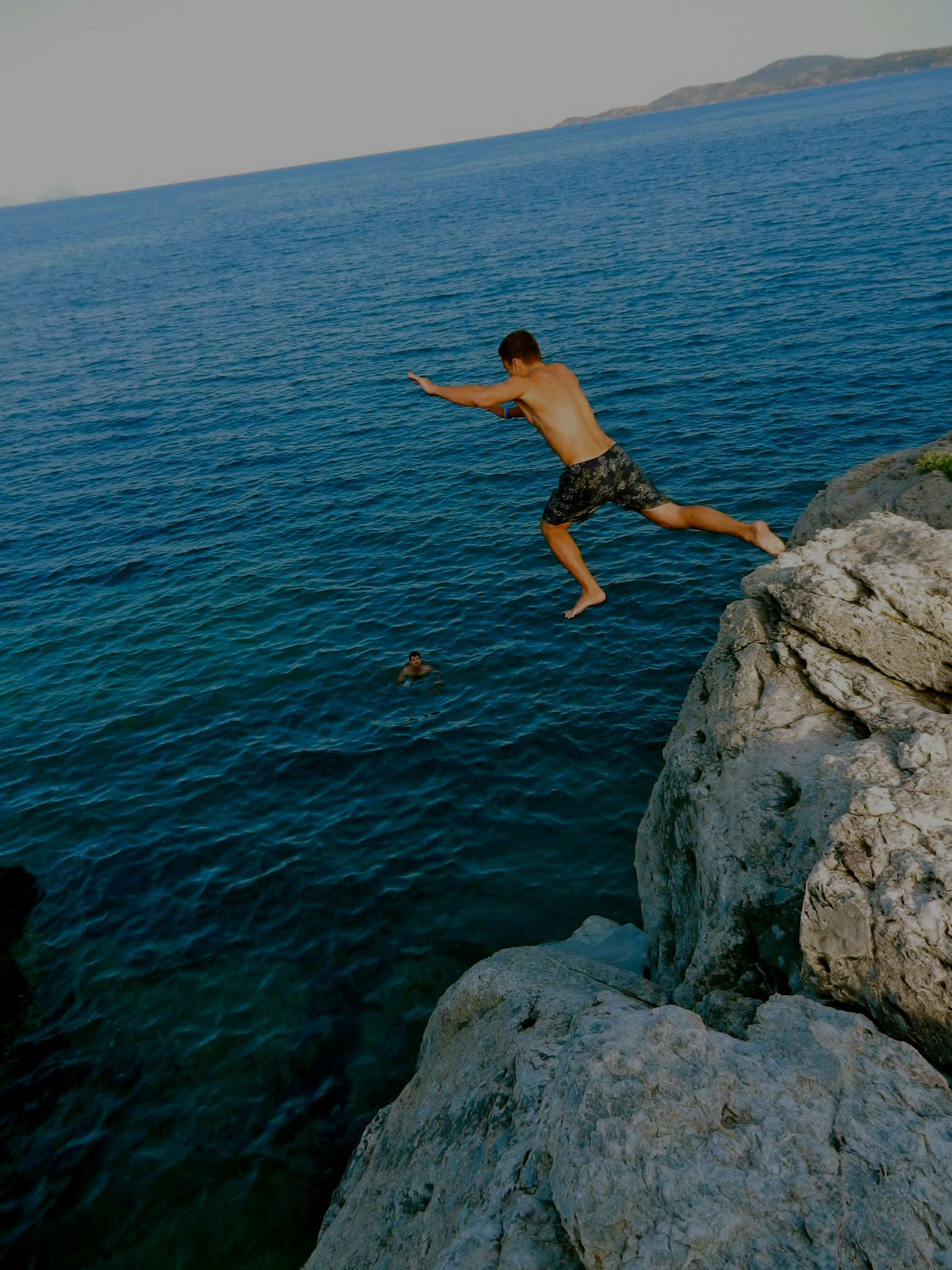 Elad Schor Jumping off a cliff in Greece